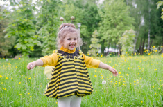 stock-photo-65380543-beautiful-girl-in-a-suit-bee-at-park-happy-child